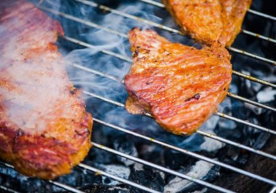 close-up-view-on-meat-on-bbq-hot-grid-grilling-PLE7TL6